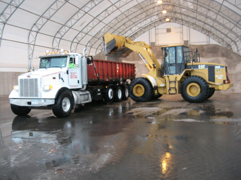 Picture-of-Loading-Bulk-Road-Salt-by-Wheel-Loader-into-Dump-Truck.png